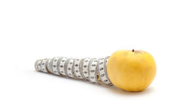 Yellow apple with measuring tape Royalty Free Stock Photo
