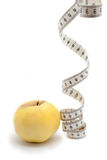 Yellow apple with measuring tape Royalty Free Stock Image