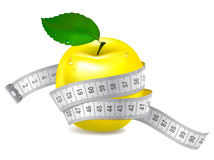 Yellow apple with measuring tape Royalty Free Stock Images