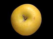 Yellow Apple Over Black Stock Photo