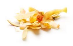 Yellow apple peelings. On the white background Stock Photos