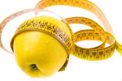 Yellow apple and ruler Royalty Free Stock Images