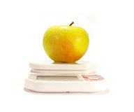 Yellow apple and scale isolared Royalty Free Stock Photos