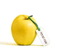 Yellow apple with 'Shanah Tova' tag. To symbolize Jewish New Year - Rosh haShanah Royalty Free Stock Photo