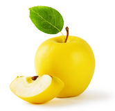 Yellow apple with a slice and leaf Royalty Free Stock Photos