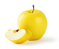 Yellow apple with a slice Royalty Free Stock Image