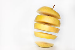 Yellow apple slices in the air Stock Image