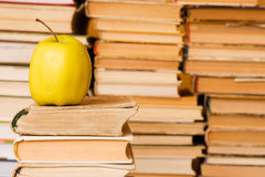 Yellow apple on stack of books Stock Image