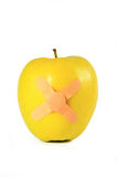 Yellow apple with strapping tape isolated Stock Photography