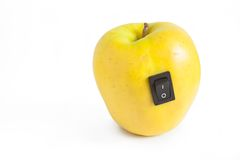 Yellow apple with switch in power off position Royalty Free Stock Photography