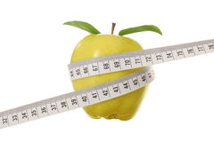 Yellow Apple and Tape Measure Royalty Free Stock Photos