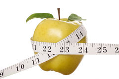 Yellow Apple and Tape Measure Stock Photos