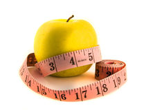 Yellow apple with tape measure Royalty Free Stock Image