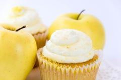 Yellow apple vs yellow cupcake Stock Image
