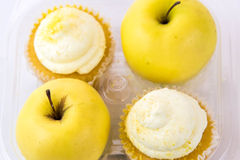 Yellow apple vs yellow cupcake Stock Photo