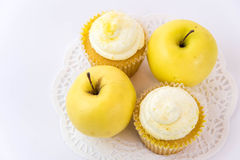 Yellow apple vs yellow cupcake Stock Photos