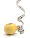 Yellow apple wiht measuring tape Stock Photos