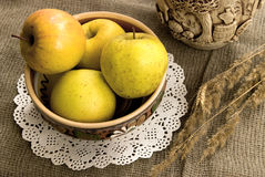 Yellow apples and ceramic foodware Royalty Free Stock Image