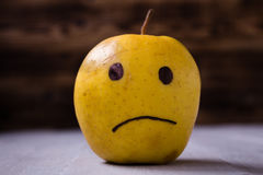 yellow apples with drawn emotions Royalty Free Stock Photography