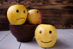 Yellow apples with drawn emotions Stock Photography