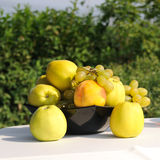 Yellow apples and grape Stock Photos