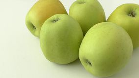 Yellow apples, isolated on white background stock video footage
