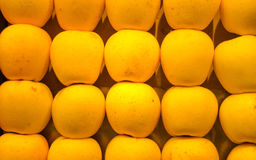 Yellow apples. Stack of yellow apples for sale at a market royalty free stock photo