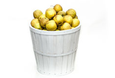 Yellow apples in a white basket stock images