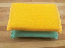 Yellow and aqua colored scrub pads Stock Image