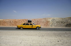 Yellow arab taxi Stock Images