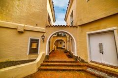 Yellow arcade in Porto Cervo. Sardinia Stock Photography
