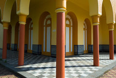Yellow arcades and terracotta columns. Building with arcades and columns in the city of Montevideo Stock Photos
