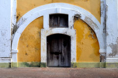 Yellow Arch Wall. A wall near old san juan in puerto rico in El Morro Stock Photo