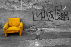 Yellow armchair Stock Photos