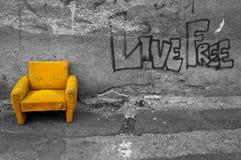 Yellow armchair. Olda yellow armchair on the street Stock Photos
