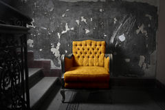 Yellow armchair Stock Image