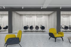 Yellow armchairs lobby, meeting room. Conference room seen from the corridor of a luxury office with dark gray and white plank walls, a concrete floor and yellow Stock Photo