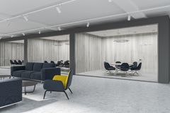 Yellow armchairs lobby, meeting room, side view. Conference room seen from the corridor of a luxury office with dark gray and white plank walls, a concrete floor Royalty Free Stock Image