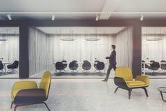 Yellow armchairs lobby, meeting room toned Stock Photos