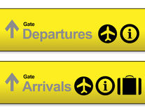 yellow Arrival and departures airport signs Royalty Free Stock Image