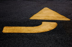 Yellow Arrow. Indicating a turn Stock Photo