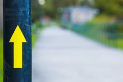 Yellow arrow. Indicating the direction to follow , saturation Stock Photo