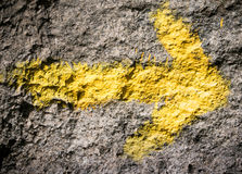 Yellow arrow at Camino de Santiago Stock Image