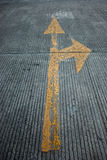 The Yellow arrow on floor street background Stock Photography