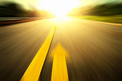 Yellow arrow Line exceeding on the road. Stock Images