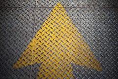 Yellow Arrow paint on steel Stock Photos