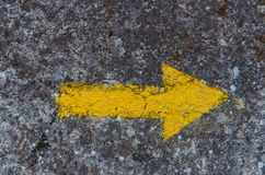 Yellow arrow painted in a wall directional sign in camino de san Royalty Free Stock Photography