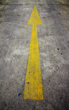 Yellow arrow on the road Stock Photography