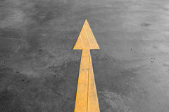 Yellow arrow road sign on the road Stock Photography