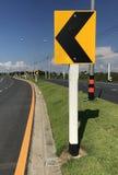 Yellow arrow sharp. Curve warning sign Stock Photography